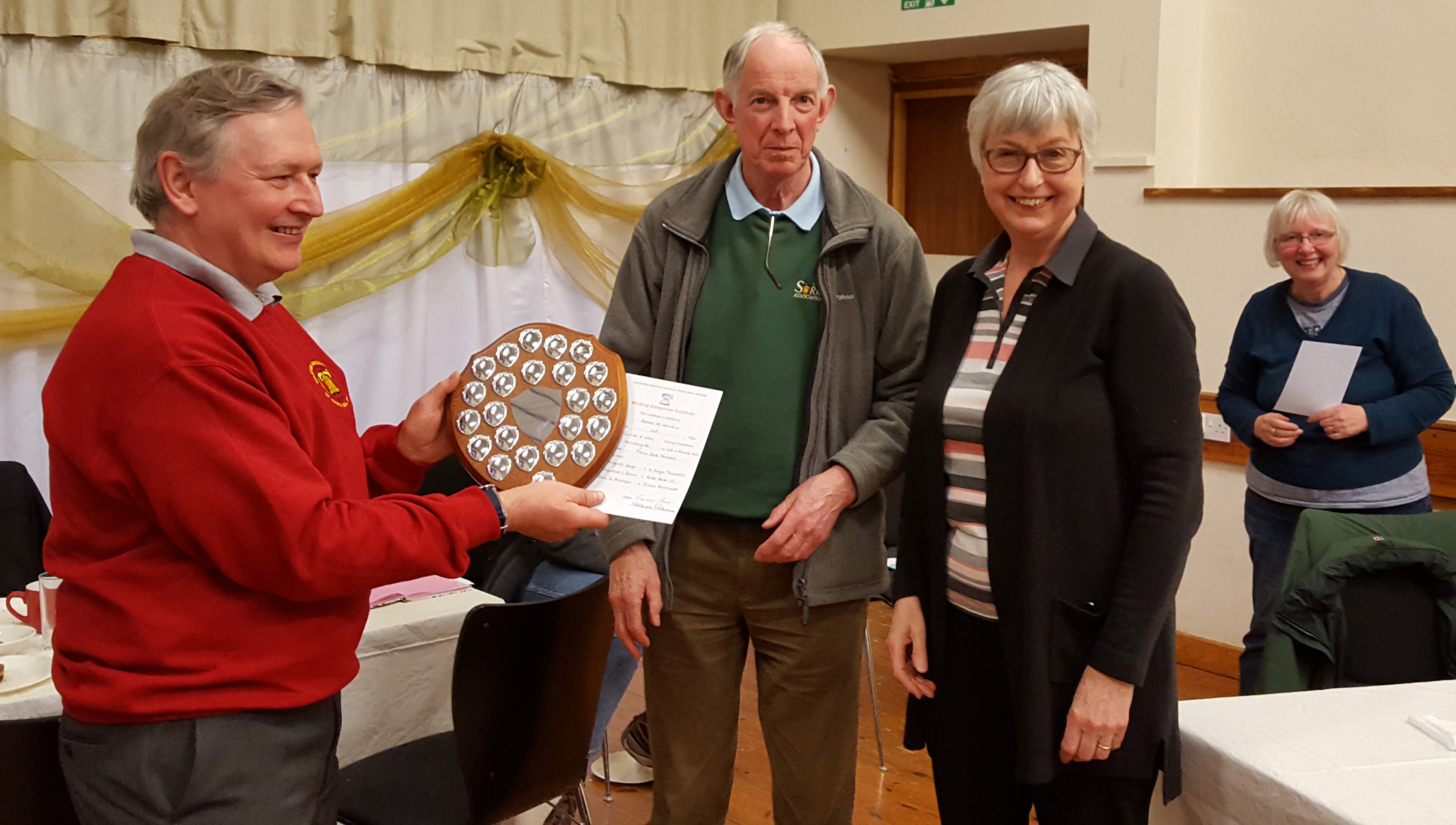 Mike Bale (Epsom) Receiving 6-bell shield from Jeremy and Sheila Cheesman, with Jackie Roberts looking on.